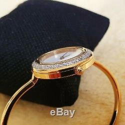 Gucci 11/12.2 18k GP Women's Bangle Watch with Diamond Cut metal Bezel (NR441)