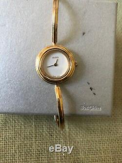 Gucci 11/12.2 18k GP Women's Bangle Watch with Gold metal Bezel