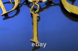Christian Dior Gold Plated Charm Ring Bag Charm Bag Accessoires Utilisés Authentique